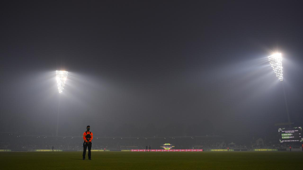 Smoke haze engulfed Manuka Oval, focing the players from the field in the Big Big clash between Sydney Thunder and Adelaide Strikers. Picture: AAP