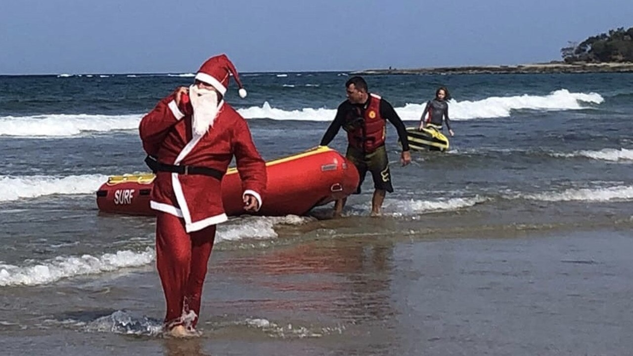 Santa arrives by IRB to the Nippers Christmas Party. Photo: Cathy Dougehrty