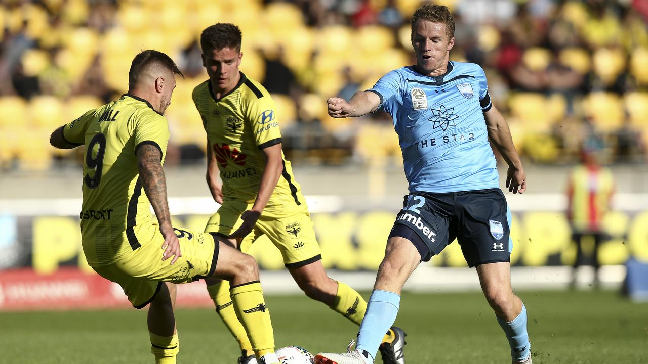 Sydney FC's Trent Buhagiar tries to slip past the Wellington defence. Picture: Getty Images
