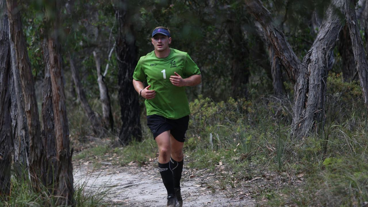 Melbourne forward Max King running through bushland. Photo: Darcy Parkinson