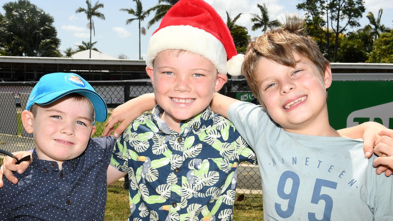 Riley Bates, 5, Bayley Bates, 6, and Luke Wallace, 8, at the Hawaiian Christmas Race Day at Mackay Turf Club at Ooralea Racecourse. Picture: Tony Martin