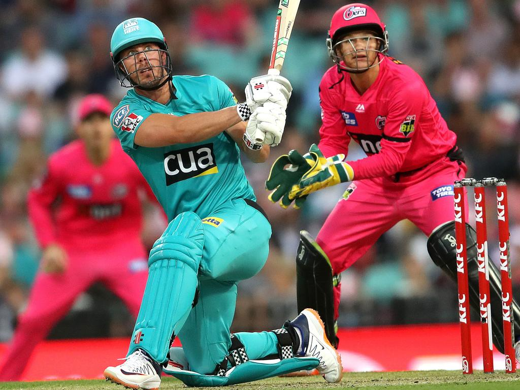 Brisbane Heat's Chris Lynn smashes a huge six against the Sydney Sixers. Picture. Phil Hillyard
