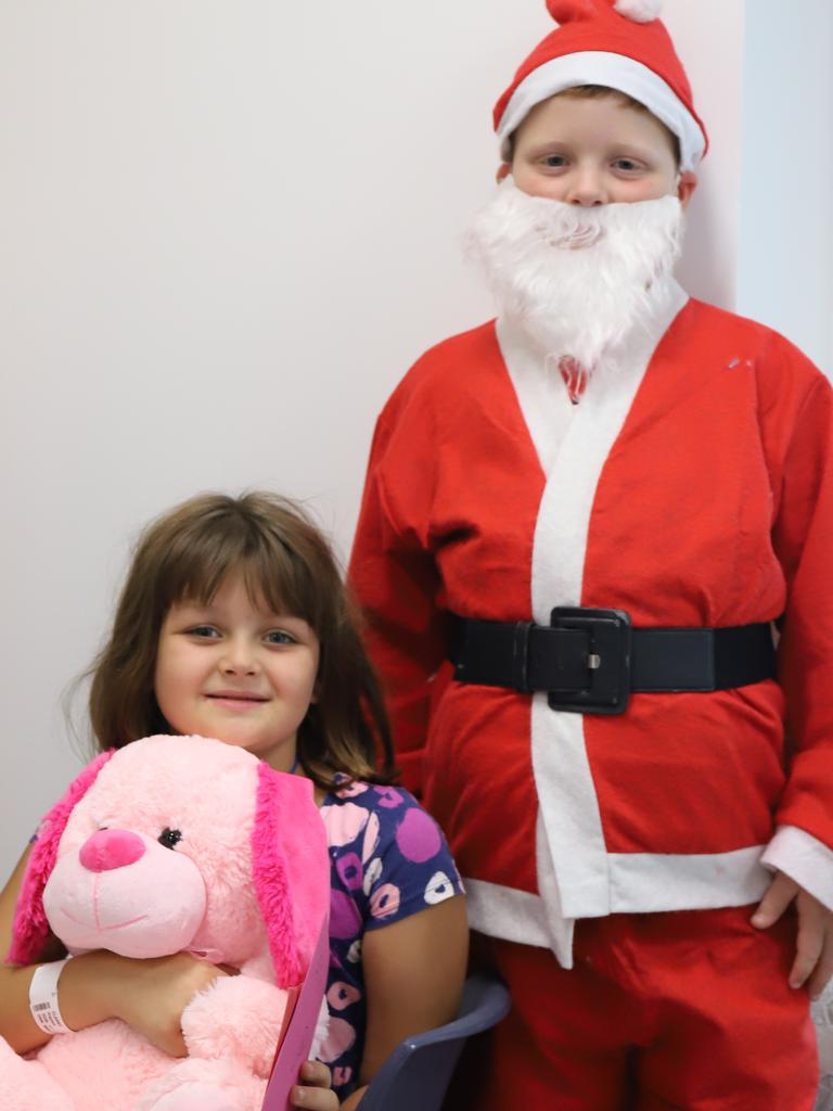 Cooper Simpson, 8, helped bring a smile to the face of Haylen Clarke, 8, who left her toy at home when she was admitted to Mackay Base.