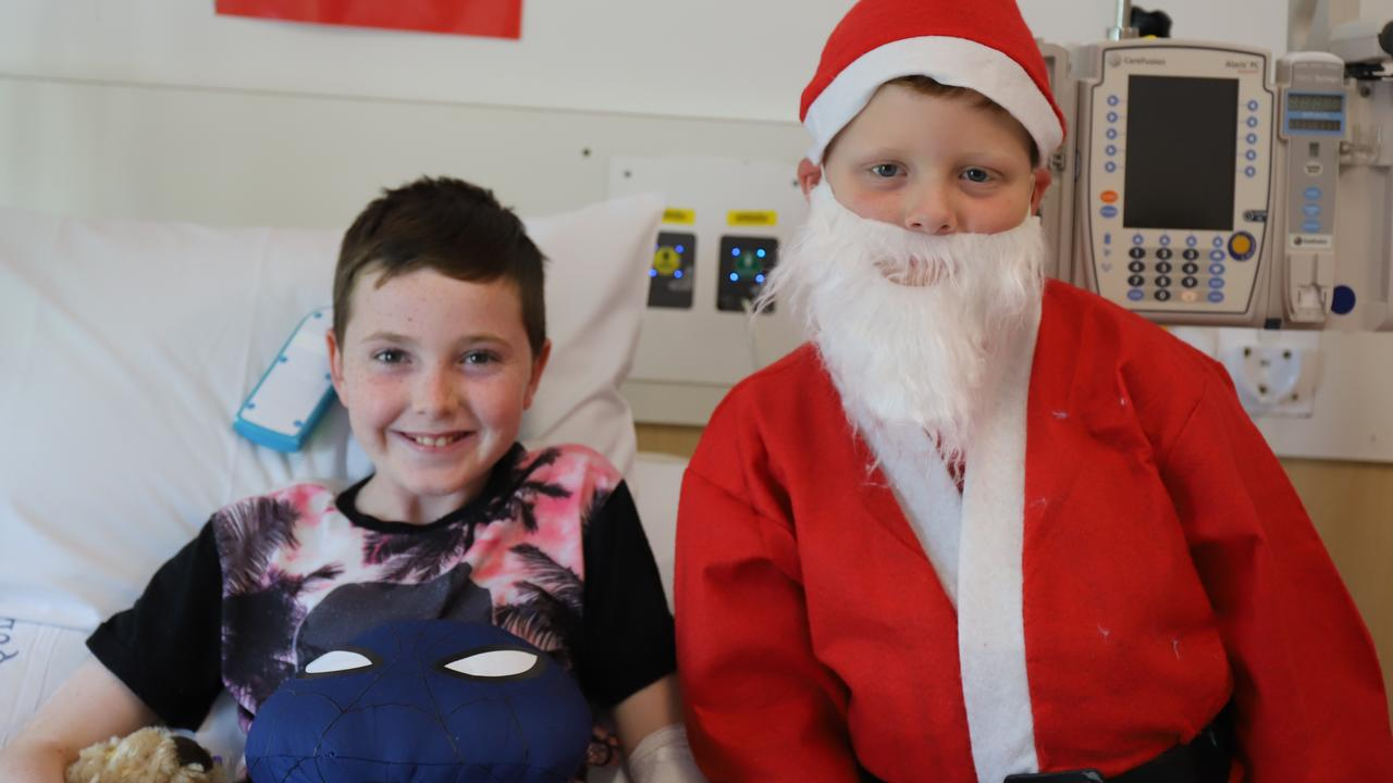 Cooper Simpson, 8, spread Christmas cheer at the children's ward and delivered toys to families. Oliver Varley, 11, was chuffed to be gifted a Spider Man toy during his recovery.