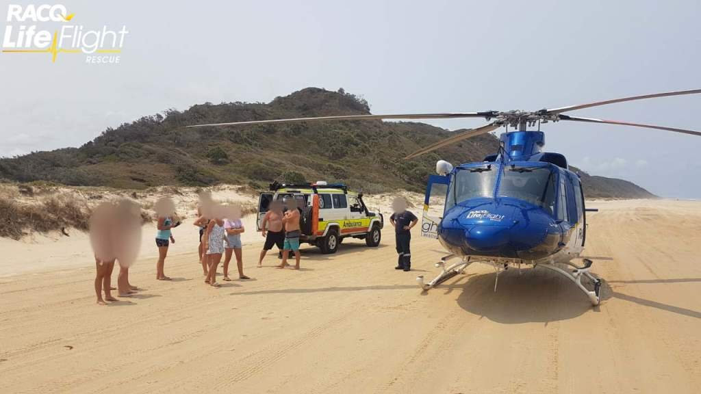 A teenage boy was left with suspected spinal injuries after a surfing incident on Fraser Island.