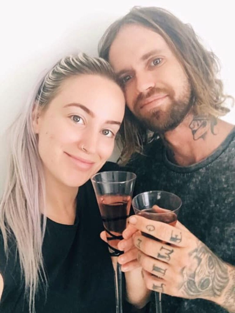 Leonie Starr and her partner Matthew Porter celebrate paying for their wedding with bottles and cans.