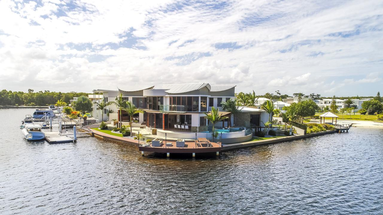 The house sits on a 1180sq m site with 67m of absolute canal frontage. Photo: Contributed