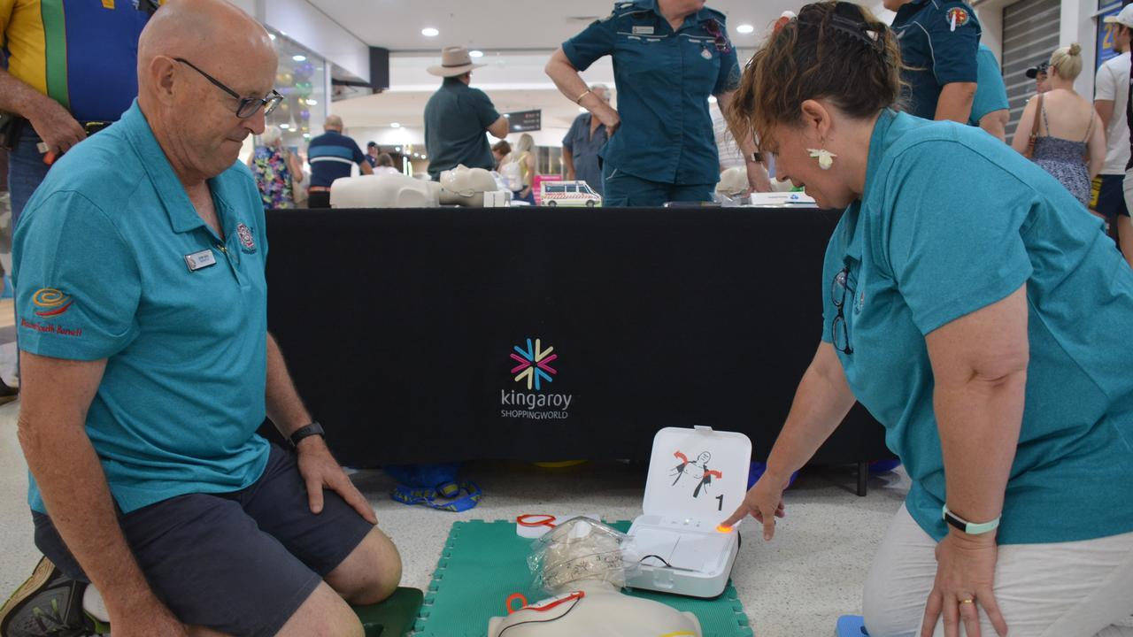 STAND BACK AND WAIT: Kingaroy Ambulance Committee president John Box and Cr Danita Potter demonstrate using a defibrillator at the Kingaroy Shoppingworld on Saturday. (Photo: Jessica McGrath)