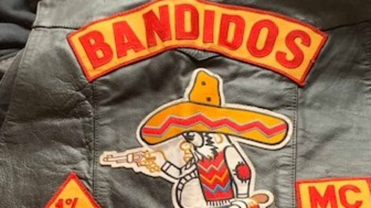 Two senior Bandidos bikie members have been charged over an alleged hit attempt.