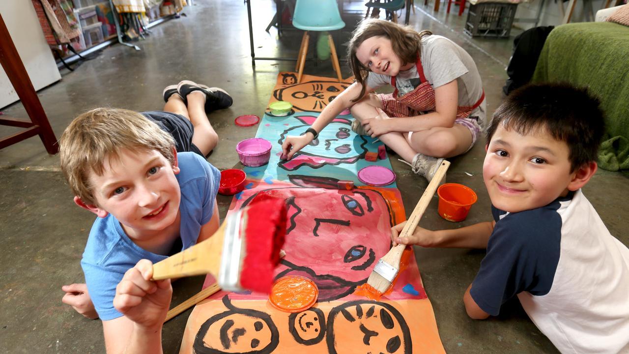 (From left) Tim Walsh, 11, Alice Falconer, 12, Ronan Lorigan, 11, enjoy a bit of art and craft.
