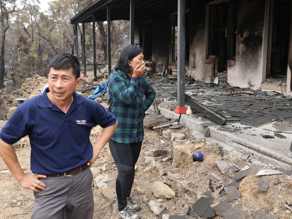 Helena and Justin Cam at their burnt out house on Station Street in Balmoral. Despite their best attempt, they were unable to save their house on Saturday. Picture Rohan Kelly