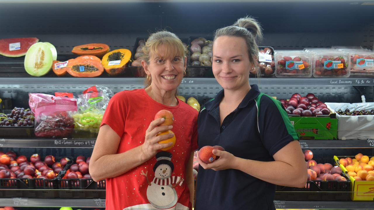DOING WHAT WE CAN: Trish Roche and Raychel Farrell help steer customers toward good deals at Percy's Fruit Market.