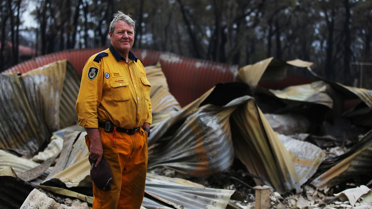 RFS Volunteer Russell Schoels on December 22 at his property that burnt down as he helped defend his neighbours property. Fires ripped through the small town of Balmoral south west of Sydney for a second time in a week. Picture: Jane Dempster