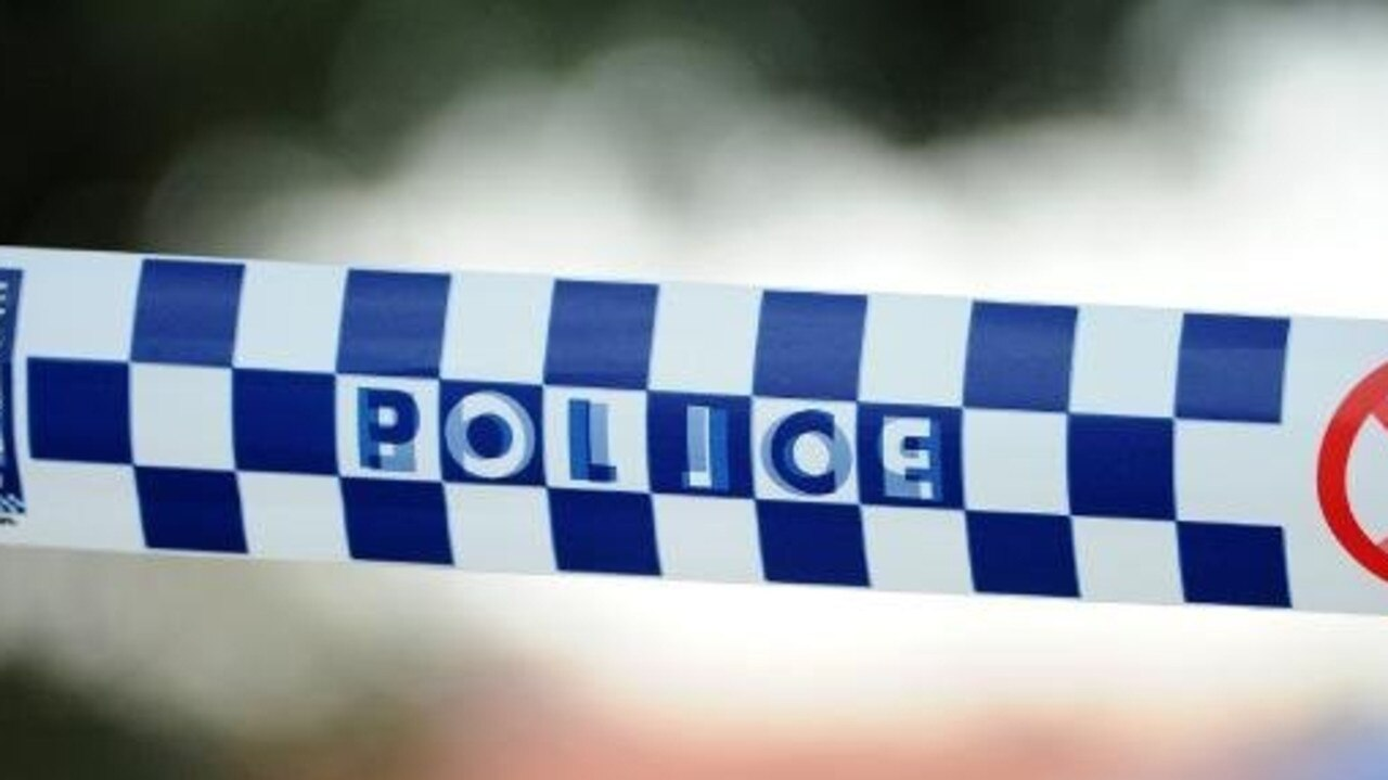 A woman is in an induced coma after a neighbour found her unresponsive in her apartment.