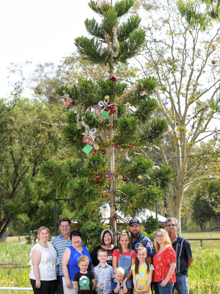 Family of Trevor Grewar have decorated Christmas tree at the Raceview dog park that was planted in his honour. (back row) Amy Sommer, Liz Sommer, Ray Sommer, Robyn Sloane, Nathan Sloane, Tegan Sloane, David Sloane and (front) Jacob Laidlaw, Hunter Sloane, Jordyn Matthews, Leo Laidlaw and Baylee Sloane.