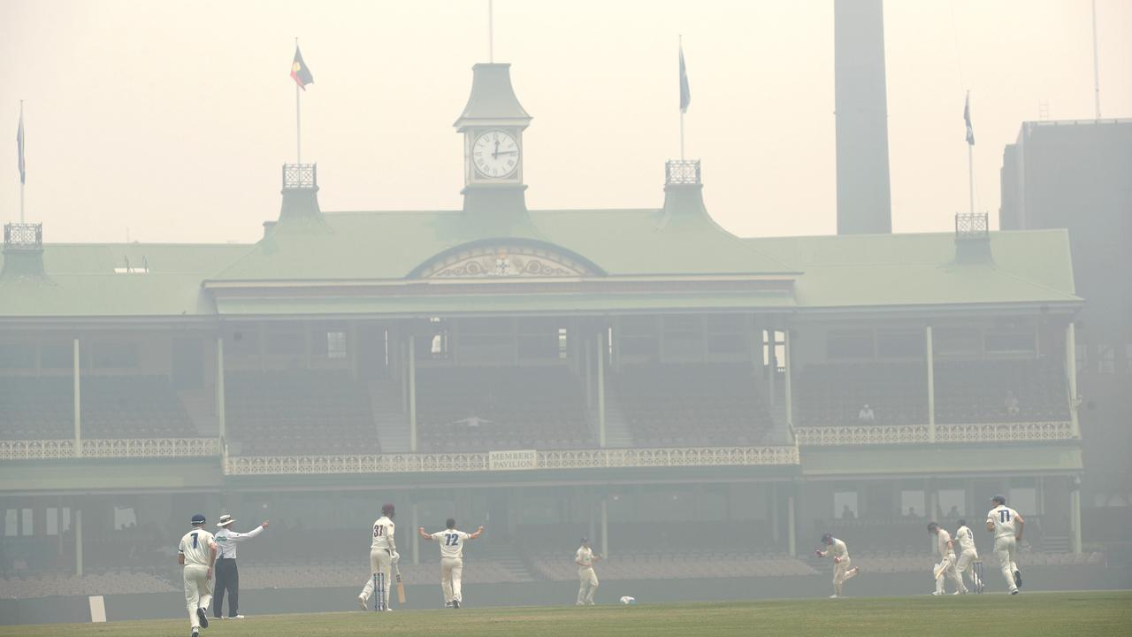 Smoke from the NSW bushfires blanketed the SCG during a Sheffield Shield match between NSW and Queensland recently. Picture: Phil Hillyard