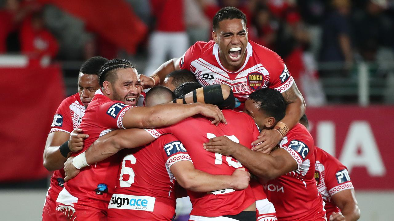 Tonga celebrate their win over Australia during the Rugby League International Test match between the Australia Kangaroos and Tonga at Eden Park on November 02. (Photo by Fiona Goodall/Getty Images)