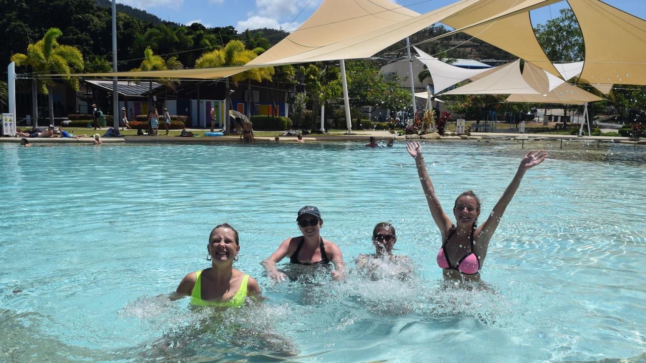 Annabelle Edwards, Camilla Hansen, Jessica Edwards, Ellie Hooper splash around at the Airlie Beach Lagoon.