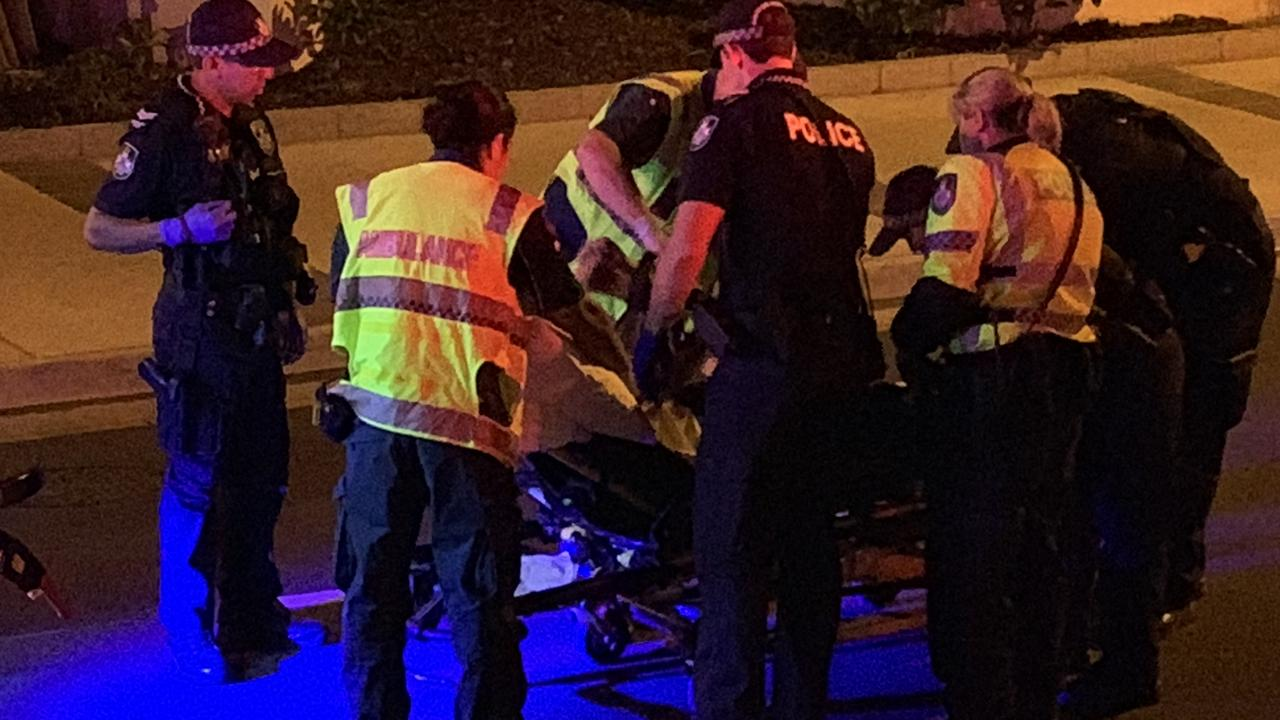 Police and ambulance staff attend to the alleged drink driver on Saturday night. Picture: Gold Coast Bulletin