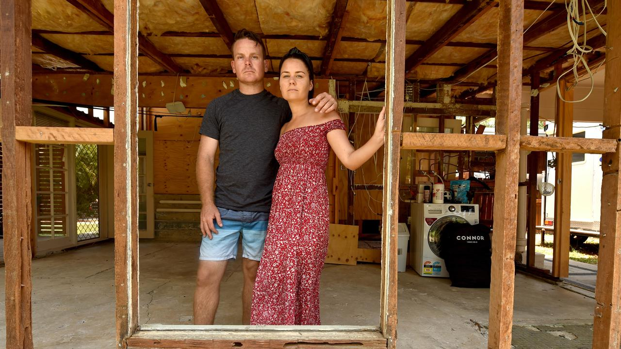 Sarah Little and Chris Baker in their flood damaged home where they are still battling their insurance company. Picture: Evan Morgan
