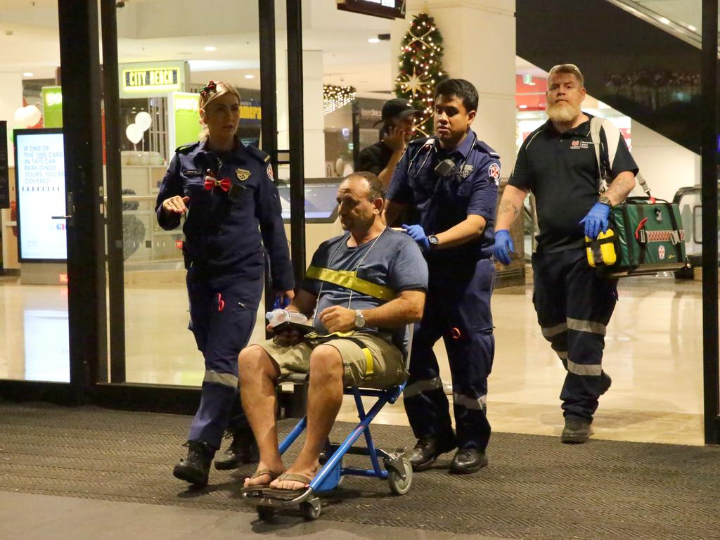 A man is wheeled out of the shopping centre after the crowd crush. Picture: Bill Hearne