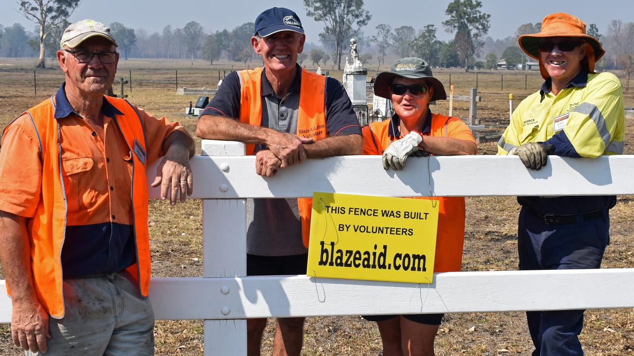 Blazeaid volunteers John and Sue Cook and Gary Cairns work with Richmond Valley mayor Robert Mustow at Wyan cemetetery near Rappville, to replace the cemetery fencing burnt in the fire.