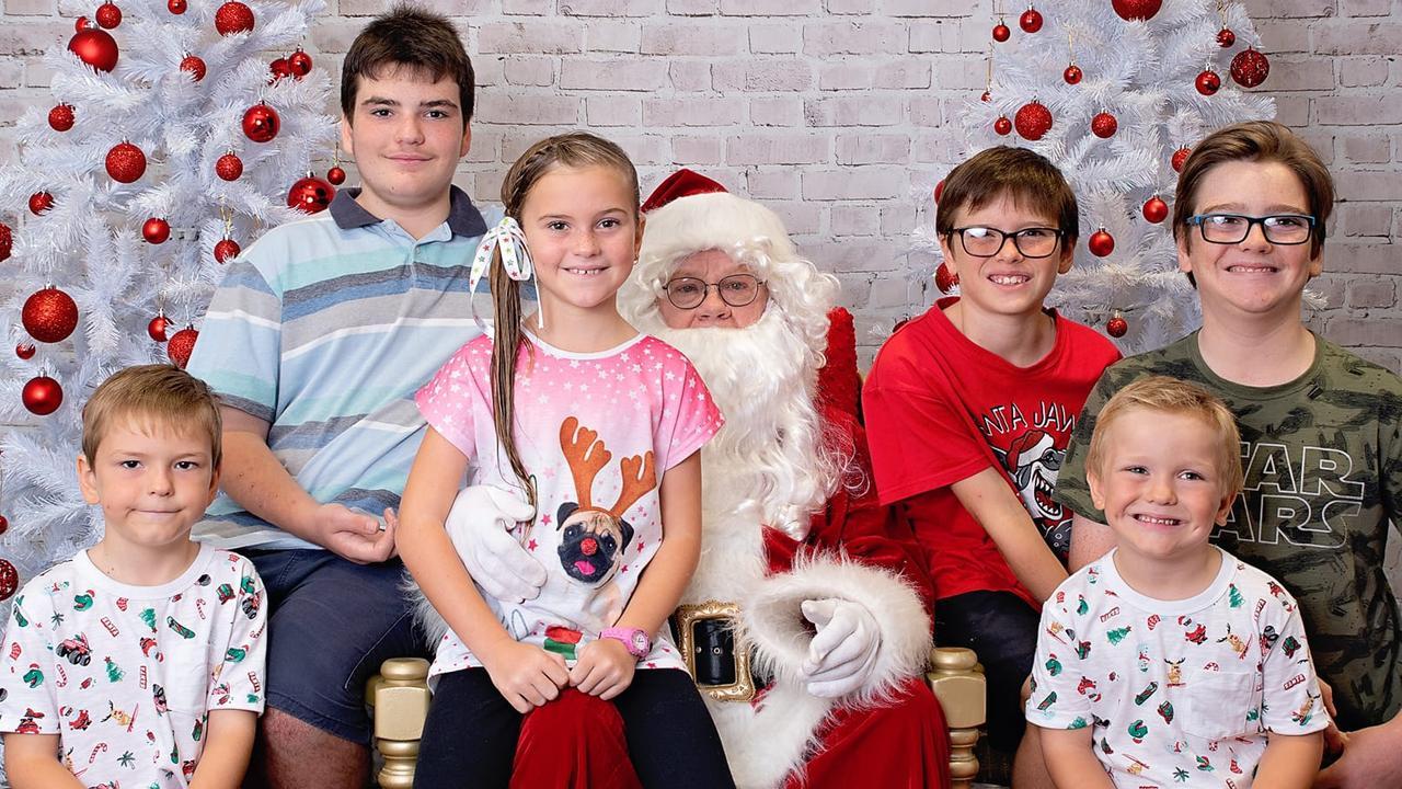 Dom, Tyrone, Blake, Anna, Harry, Robert Sylvester enjoy their chance to meet Santa. Photo: Kristy Sylvester