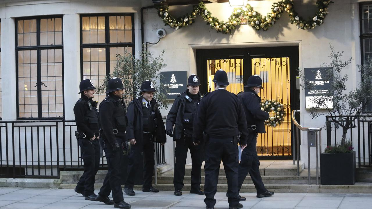 Police officers outside the main entrance of King Edward VII Hospital, where Prince Philip is being treated. Picture: Philip Toscano/PA via AP