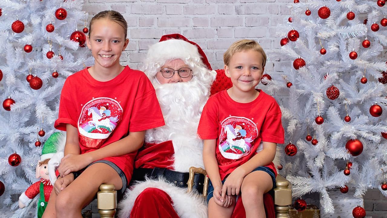 Samantha Ayles and Hope Ayles meet Santa before Christmas Day. Photo: Maureen Mo