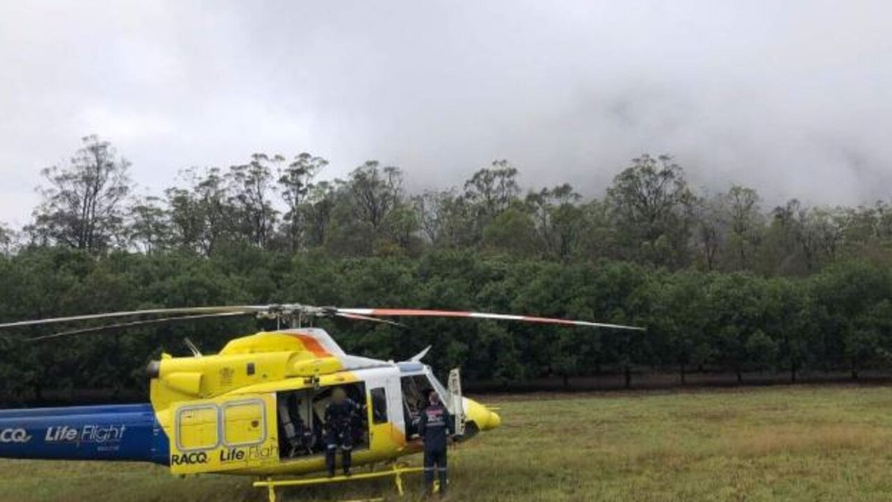 The LifeFlight helicopter prepares to rescue a man trapped on Mount Beerwah after suffering multiple injuries