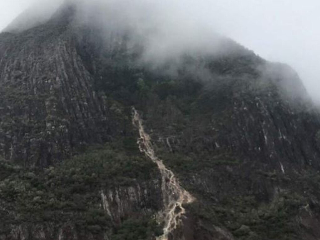 Drizzling rain and cloud cover over Mount Beerwah this morning where a man was rescued after badly injuring himself in a 20-metre fall.