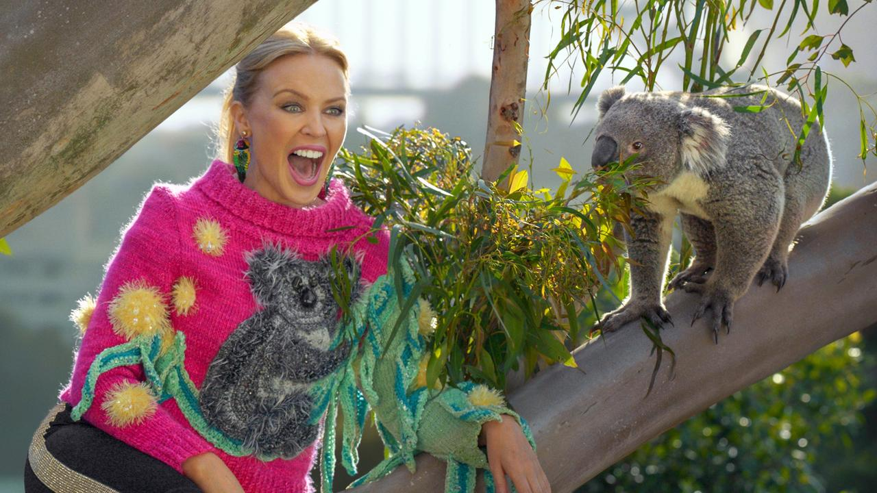 Kylie Minogue meets a koala at Uluru in the Northern Territory. Pic: Tourism Australia