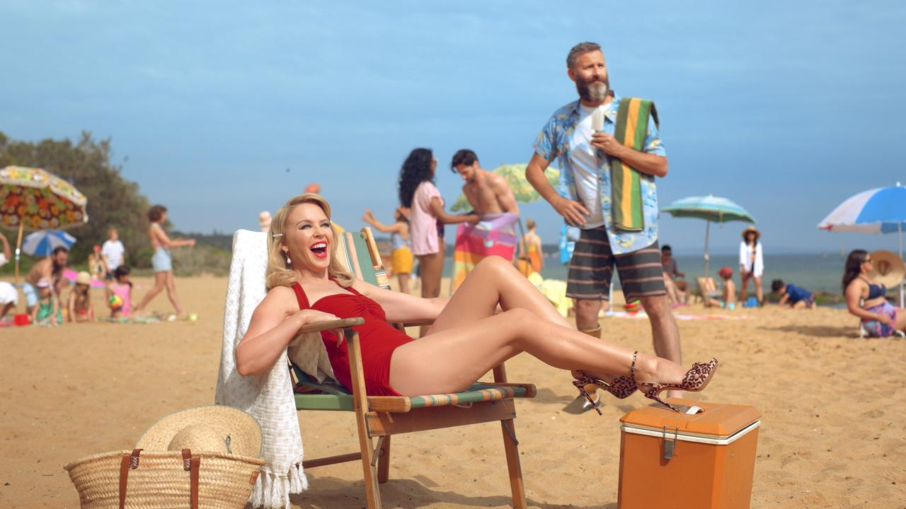 Kylie Minogue and Adam Hills at Sandringham Beach in Victoria. Pic: Tourism Australia