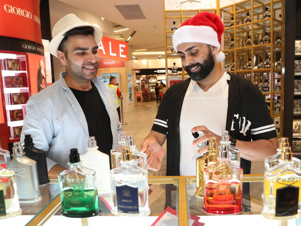 Apun Khanna from St Kilda West, 34 and Sinchit Takkar, Hallam, 30, shopping for perfume in Myer in Melbourne. Picture: David Crosling