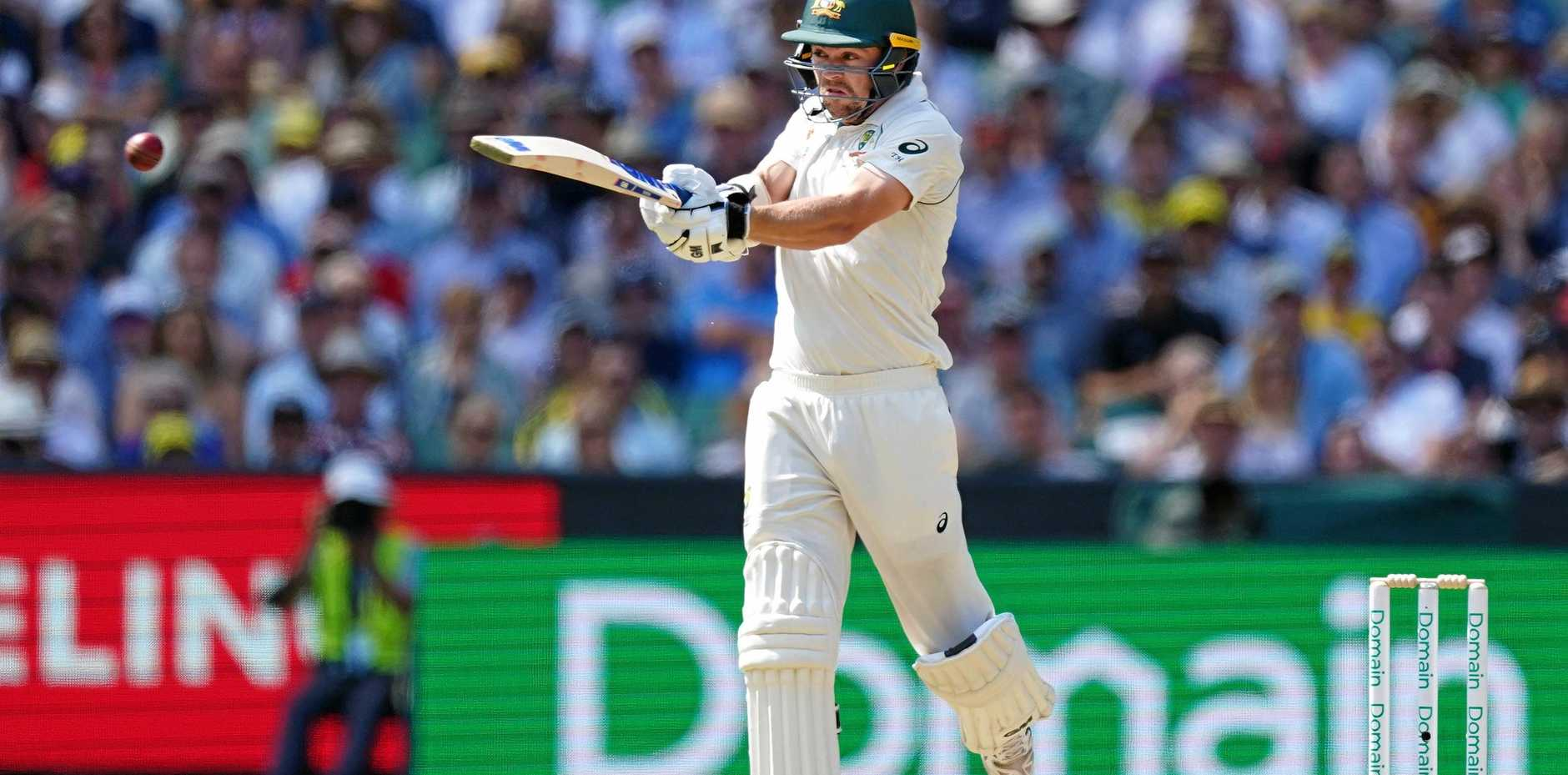 Travis Head hits out on his way to a century for Australia at the MCG. Picture: Scott Barbour/AAP
