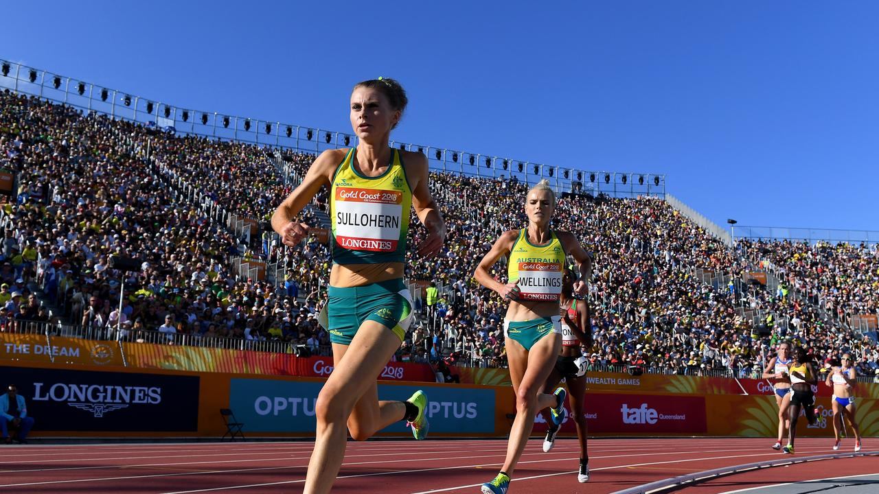 Celia Sullohern (left) and Eloise Wellings of Australia compete in the Women's 5000m Final on day ten of the XXI Commonwealth Games, at Carrara Stadium on the Gold Coast, Australia, Saturday, April 14, 2018. (AAP Image/Dean Lewins)