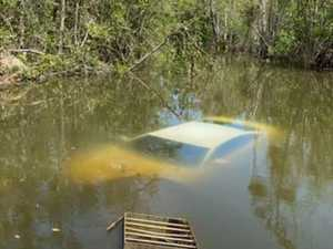 Car crashes off bridge into crocodile-infested creek