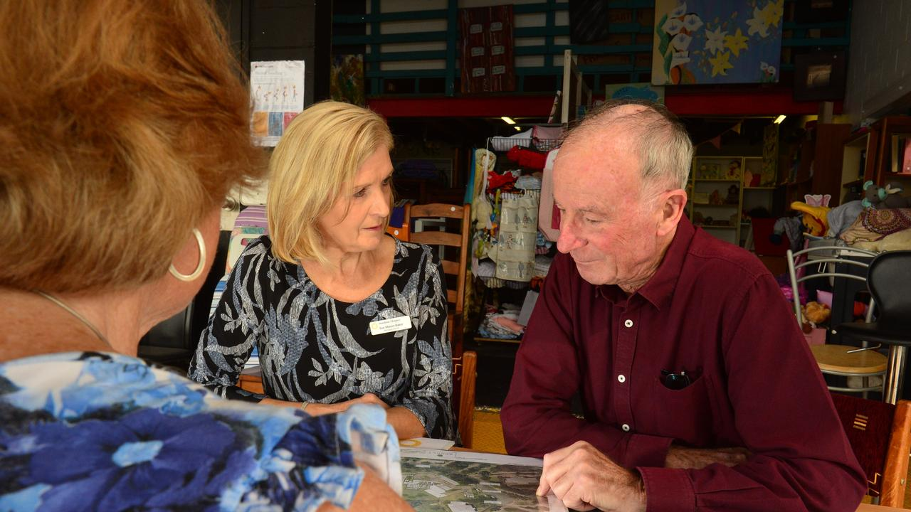 Sue Mason-Baker and Frank Lewins of the Sunshine Coast Hospice Charity check out the plans for the new premises in Buderim.