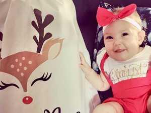 FIRST CHRISTMAS: Adorable bubs soak up festive spirit