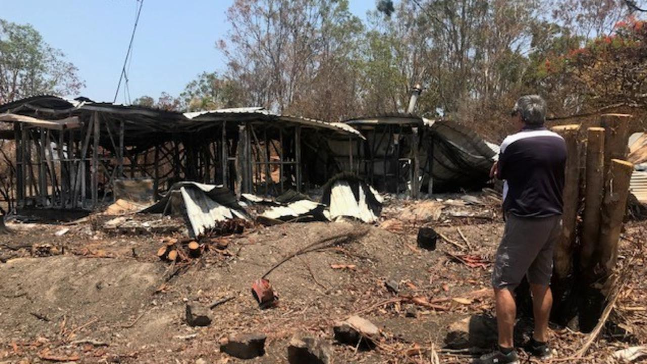 Vinnies volunteer Rick Williams in front of a Yeppoon home destroyed by bushfire.