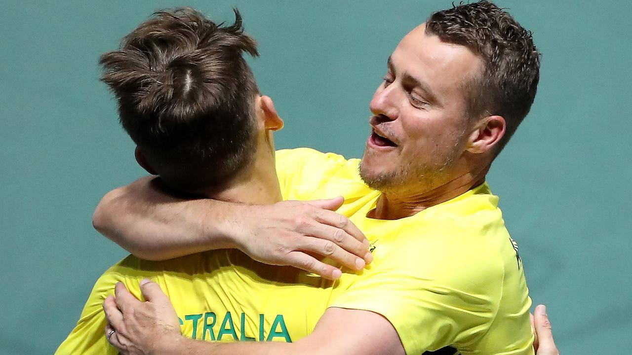 Hewitt hugs Alex de Minaur after a Davis Cup match. Picture: Alex Pantling/Getty