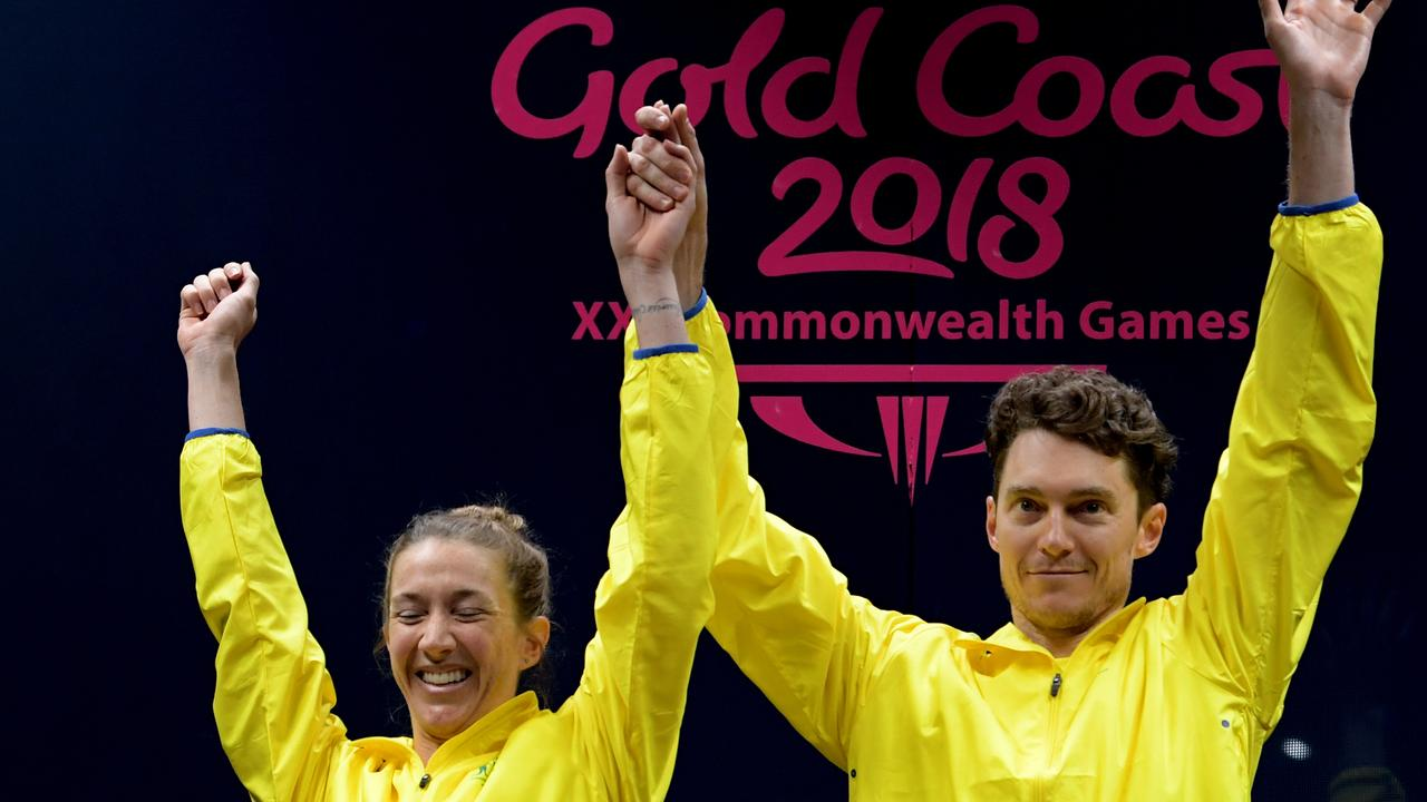 Gold medalist Donna Urquhart (left) and Cameron Pilley of Australia during the medal ceremony for the Mixed Doubles Gold Medal Squash Match on day ten of competition at the XXI Commonwealth Games at the Oxenford Studios on the Gold Coast, Australia, Saturday, April 14, 2018. (AAP Image/Tracey Nearmy)