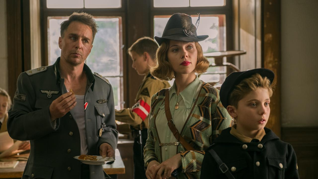 Sam Rockwell, Scarlett Johansson and Roman Griffin Davis in a scene from the movie Jojo Rabbit.Picture: Twentieth Century Fox