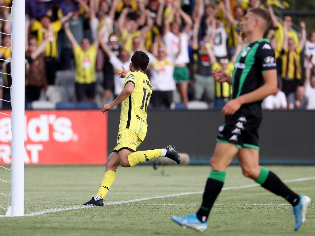 Ulises Alejando Davila Plascenia celebrates his goal pointing to the Wellington Phoenix fans.