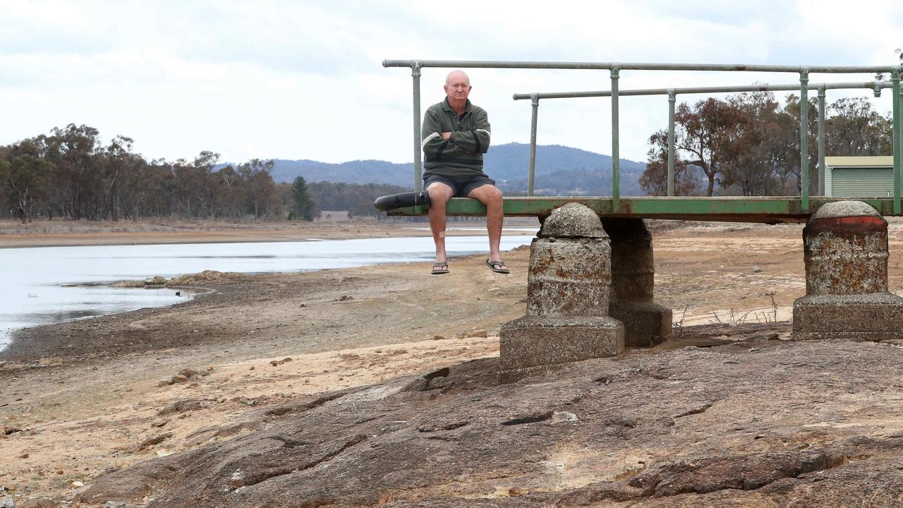 Bill Lynam, 75 of Ballandean, on the banks of the nearly empty Storm King Dam at Stanthorpe. Picture: Liam Kidston.