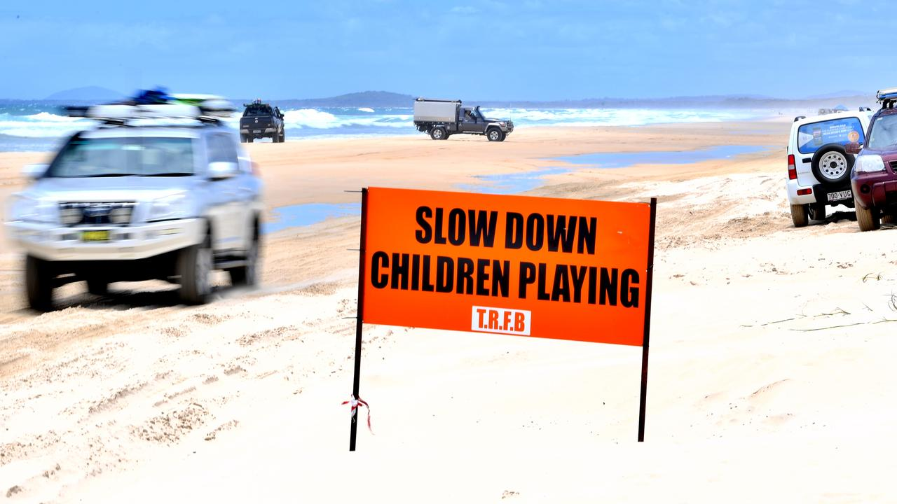 Police officers on the beach at Teewah conduct alcohol, drug and speed testing of drivers. Photo: John McCutcheon / Sunshine Coast Daily
