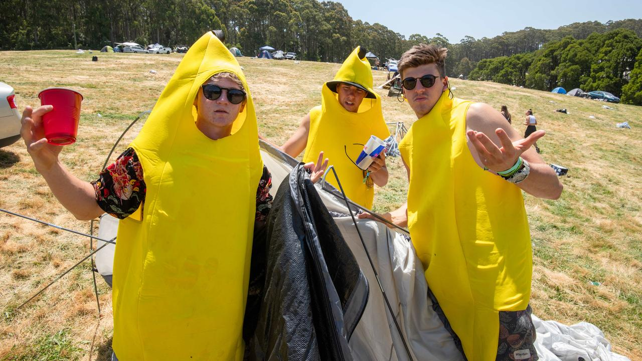 Max Mackay, 19, Jesse Barker, 19 and Scotty Morris, 18, pack up their site. Picture: Jason Edwards