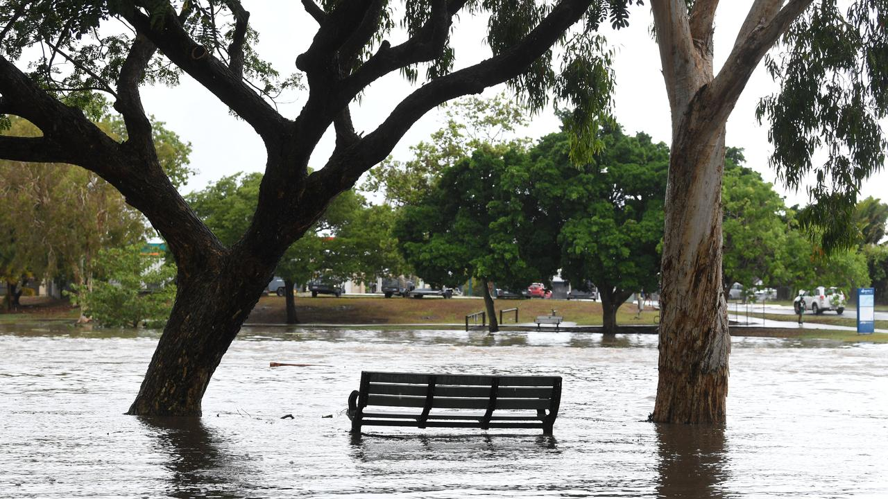 A park bench is surrounded by water after the heavy rainfall in Mackay on Saturday. Picture: Tony Martin