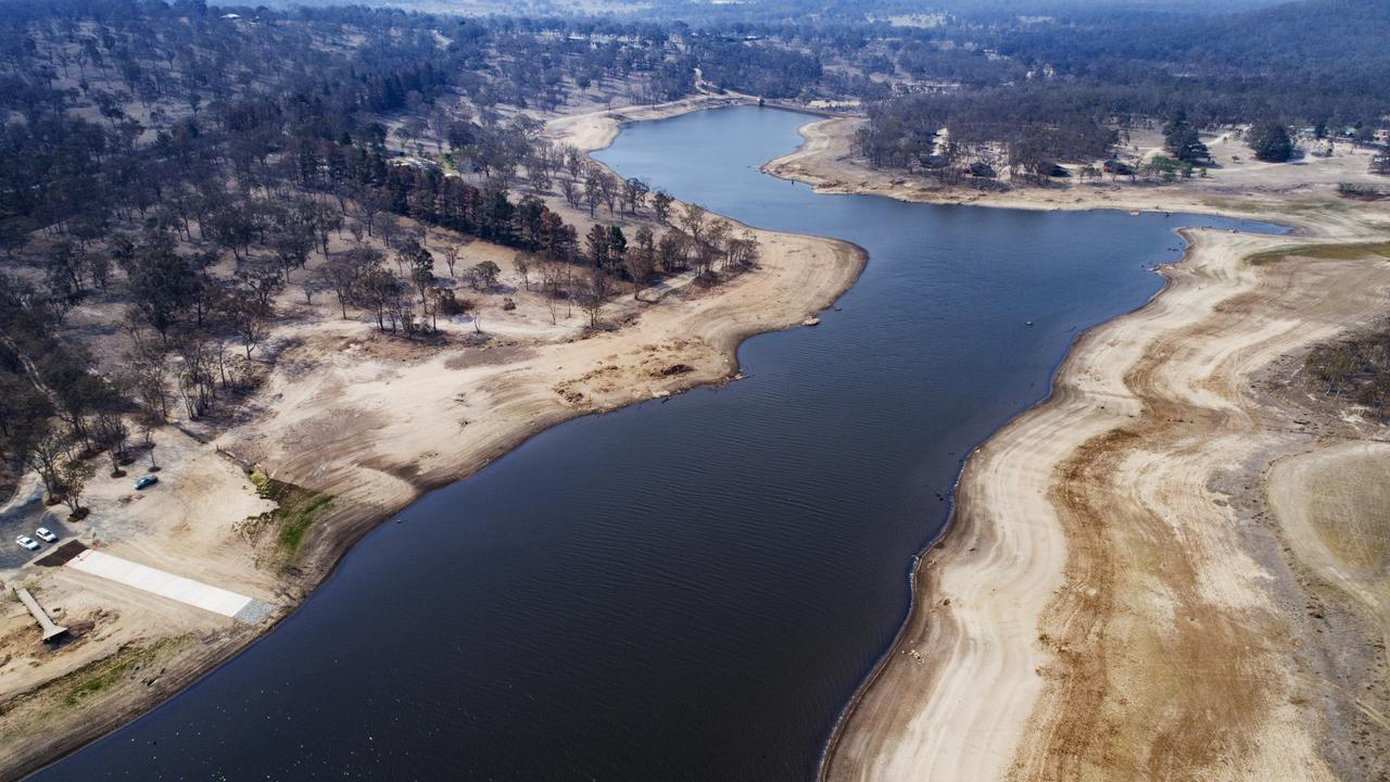 An aerial photograph shows the rapidly receding Storm King Dam at Stanthorpe. Picture: Lachie Millard