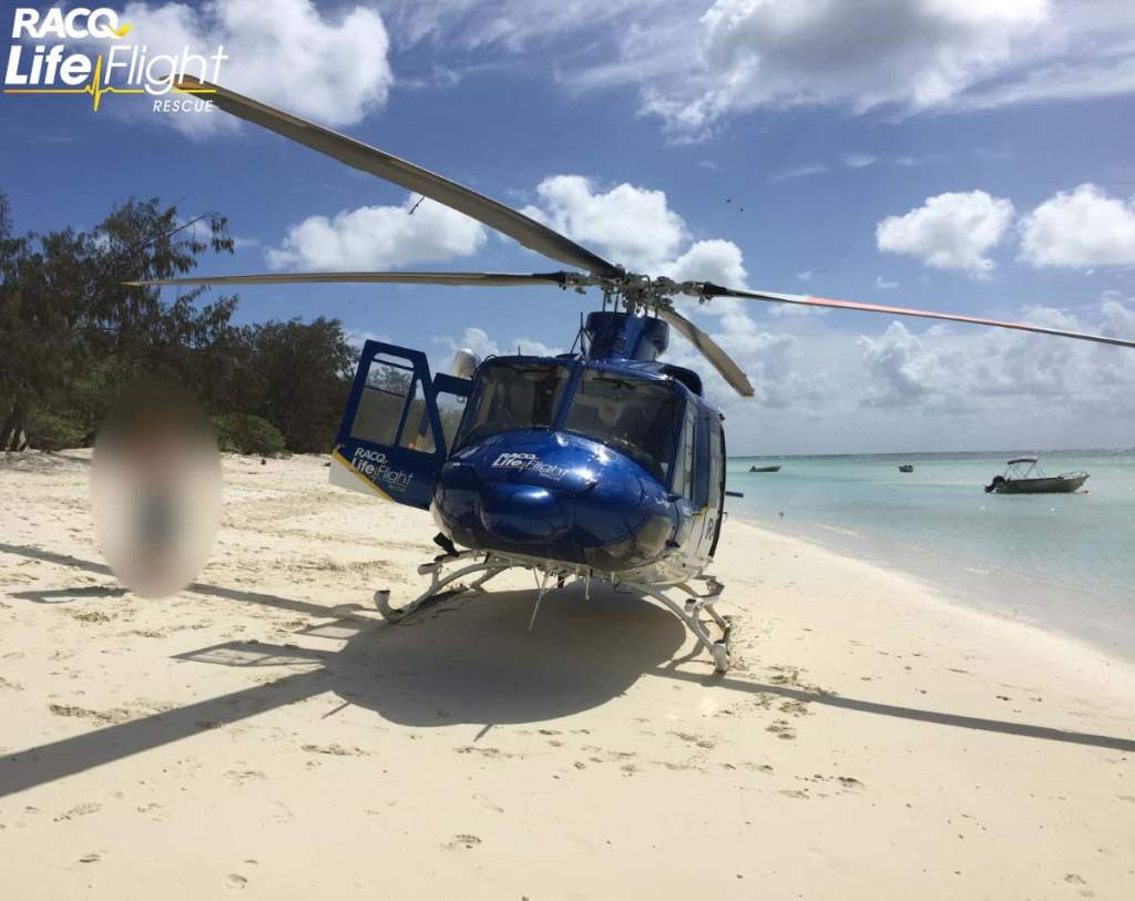 RACQ LifeFlight Rescue airlifted a man from North West Island to Gladstone Hospital after a shark bite